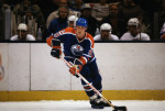 14 Nov 1981, New York, USA --- Wayne Gretzky, of the Edmonton Oilers, controls the puck during a game at Nassau Coliseum on Long Island in New York. --- Image by © Bettmann/CORBIS